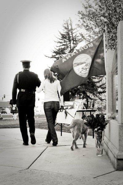 Police Officer Walking with Woman and Dog
