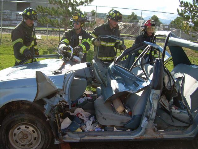 Firefighters reviewing a car crash